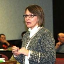 Gina Tynes, of Hocker Family Insurance, speaks to magistrates.  (file photo).  Tynes joined Rob Brown of KACO in presenting Fiscal Court a $7,196.07 dividend check for Worker's Comp.