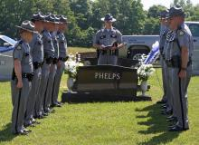 Kentucky State Police Post 3 personnel at the grave of Trooper Darrell Vendl Phelps.