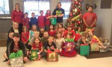 Ms. Elmore's class presenting gift bags to Mr. Richie Bratcher of BCCA.