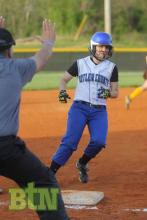 Coach Embry holds Madeline Drake at third