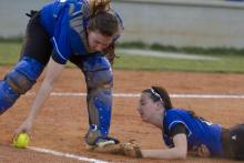 Amy Rogers fields the bunt.