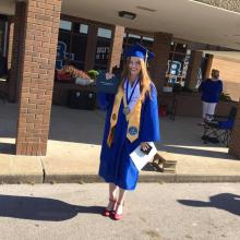 Valedictorian Emily Tyree with her diploma. Tyree gave the traditional speech at Saturday's event.