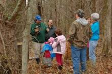 Greg Drake prepares to tap a tree for a maple syrup production class in 2012